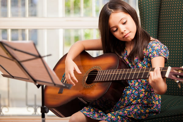 Play Music - Guitar Lessons